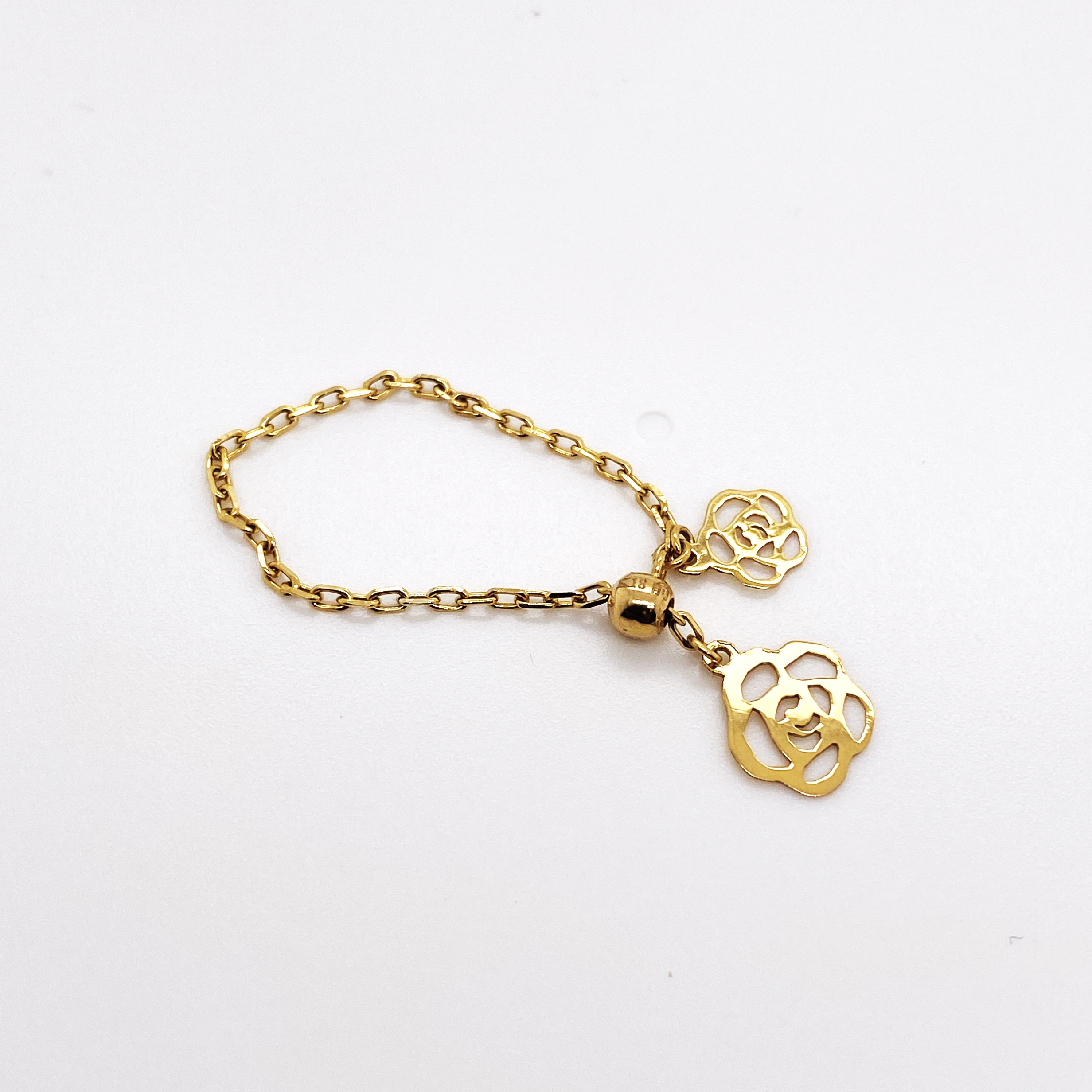 0.79 grams 18K SD Gold Adjustable ring with Heart